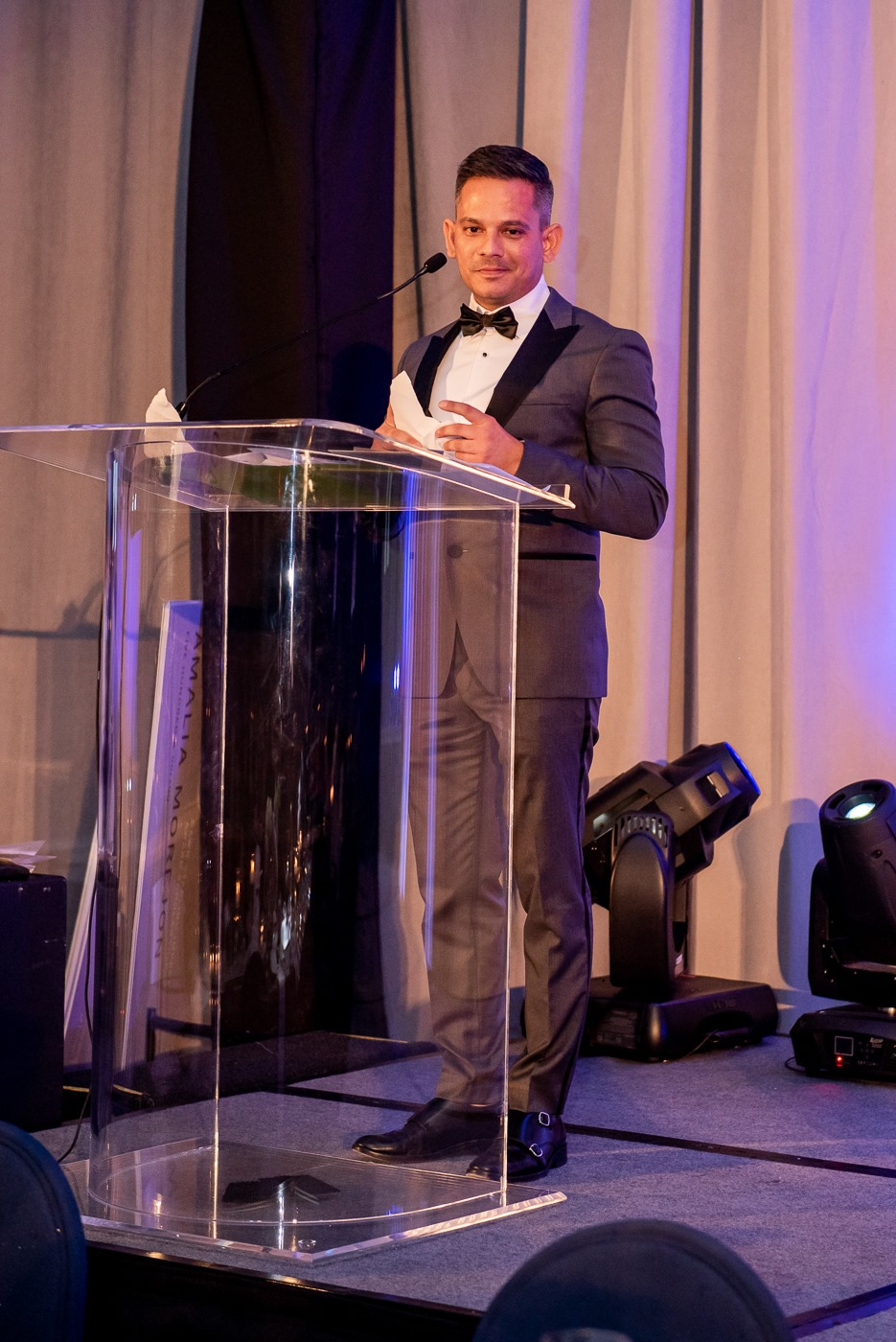 CUBE 3's Elieser Duran presenting the award for Best Retail Space